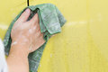 Hand with cloth cleaning dirty car wash Royalty Free Stock Photo