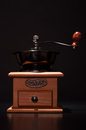 Hand coffee grinder on black background Royalty Free Stock Photo