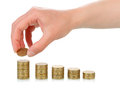 Hand with coins stacks human isolated on white background Royalty Free Stock Image