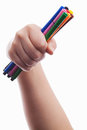 Hand with colorful pens Royalty Free Stock Photos
