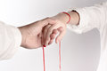 A hand of couple touch each other. The Faith of red thread brings destiny Royalty Free Stock Photo