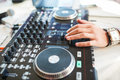 Hand of DJ on the decks Royalty Free Stock Photo