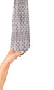 Hand drag necktie on white background Royalty Free Stock Photography