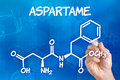 Hand drawing the chemical formula of aspartame with pen Royalty Free Stock Photography