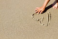 Hand drawing heart in the sand Royalty Free Stock Photo