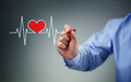 Hand drawing heartbeat graph on screen with a pen concept for healthy lifestyle pulse trace Stock Photos