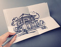 Hand drawing house on white folding paper background Royalty Free Stock Photo