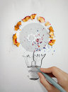 Hand drawing light bulb with pencil saw dust Royalty Free Stock Photo
