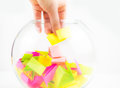 Hand drawing lots of a bowl small colorful paper pieces cut for randomly Royalty Free Stock Photos