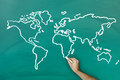 Hand drawing world map on blackboard Royalty Free Stock Photo