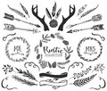 Hand drawn antlers arrows feathers ribbons and wreaths with lettering rustic decorative vector design set vintage ink illustration Royalty Free Stock Photo