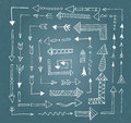 Hand drawn arrow icons set on blue chalk board Royalty Free Stock Photo