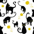 Black cats silhouettes seamless pattern. Vector illustration of cats with wool cloths on white background