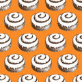 Hand drawn cinnamon roll buns seamless pattern. Orange background.
