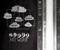 Hand drawn cloud network with light bulb doodle on dark wall background as concept Royalty Free Stock Image