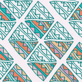 Hand drawn colorful triangle seamless pattern with green, pink, blue, orange details. Doodle triangles on beige.