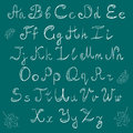 Hand Drawn Doodle Font and Leaves.Chalk Scribble Alphabet on Green Background.
