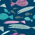 Fish seamless pattern. Colorful fish with stripes ans dots. Vector illustration on dark blue background