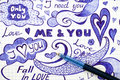 Hand drawn love doodles messages on checkered paper with pen