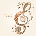 Hand-drawn music key with ethnic ornaments doodle pattern. Royalty Free Stock Photo