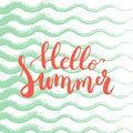Hand drawn phrase Hello Summer on the green sea waves background. Hand lettering calligraphy greeting card Royalty Free Stock Photo