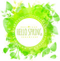 Hand drawn round frame text hello spring. Green watercolor splash texture with printed leaves. Artistic vector design for spring