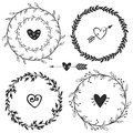 Hand drawn rustic vintage wreaths with hearts. Floral vector