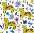 Hand drawn seamless background with tigers and flowers.