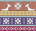 Hand drawn seamless knitted background in fair isl isle style with deers and snowflakes Royalty Free Stock Images