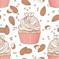 Hand drawn seamless pattern with doodle cupcake, almond and buttercream. Food background