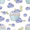 Hand drawn seamless pattern with doodle cupcake and blueberry buttercream. Food background