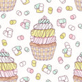 Hand drawn seamless pattern with doodle cupcake, marshmallow and buttercream. Food background