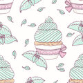 Hand drawn seamless pattern with doodle cupcake and mint buttercream. Food background. Vector illustration