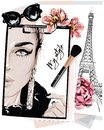 Hand drawn stylish table set with notes, sketches, makeup brush, sunglasses and flowers. Woman face sketch and eiffel tower.