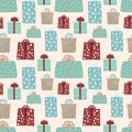 From hand drawn vector illustration of multi-colored gifts on a beige background. Seamless pattern for Christmas and New Year.