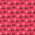Hand drawn vector seamless pattern with XOXO on red background