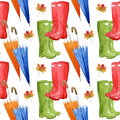 Hand drawn watercolor seamless pattern with autumn elements. Umbrella, leaf, rubber boots. Royalty Free Stock Photo