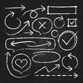 Hand drawn white chalk arrows, circle frames and sketch graphic elements on blackboard vector set Royalty Free Stock Photo