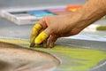 Hand Draws Chalk Art On Street At Fall Festival