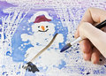 Hand draws a snowman Stock Photography