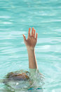 Hand of drowning person stretching out of water a sea pool and asking for help Royalty Free Stock Photos