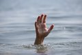 Hand drowning on the sea Royalty Free Stock Photo