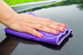 A Hand drying a back car Royalty Free Stock Photo