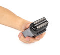 Hand with electric shaver on a white background Stock Image
