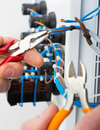 Hand electrician tools electrical switchgear cabinet Royalty Free Stock Photo