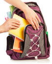 Hand with exercise book and bag student male putting an in isolated on white Royalty Free Stock Photo