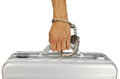 Hand fastened with handcuffs to briefcase aluminium isolated Stock Photo