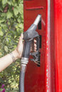 Hand of female holding a fuel pump Royalty Free Stock Photo