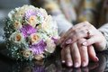 Hand with flowers on the wooden table Royalty Free Stock Image
