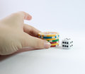 Hand gambling with casino chips and a white dice Royalty Free Stock Photos